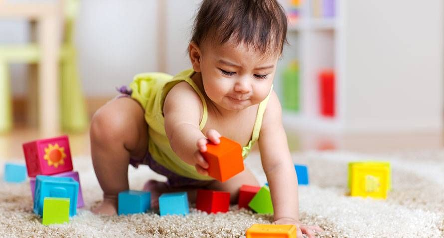 baby learning independent play